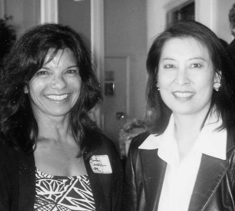 Shirley Davalos and Emerald Yeh of KRON-TV enjoy the celebration.