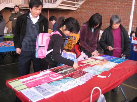 Fair participants looking at brochures